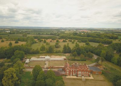 Manor House and Glasshouse - Overhead Front View